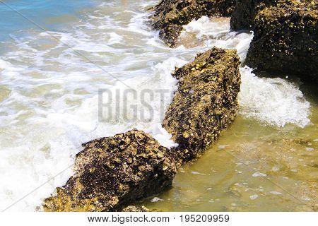 Water rushing over rocks in the ocean