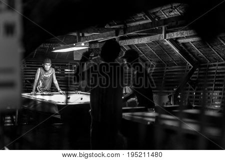 BORACAY WESTERN VISAYAS PHILIPPINES - JANUARY 16 2015: Black and white picture of filipinos playing snooker.