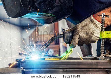 Close Up Man Weld A Metal Welding Machine