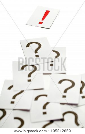Exclamation mark on top of a lot of question marks - solution or idea concept