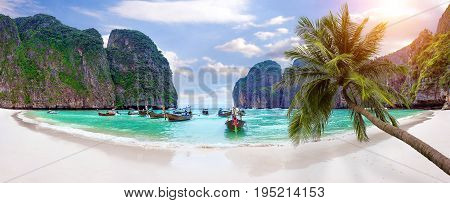 Panorama of Long boat and blue water at Maya bay in Phi Phi Island Krabi Thailand.