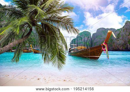 Long boat and blue water at Maya bay in Phi Phi Island Krabi Thailand.
