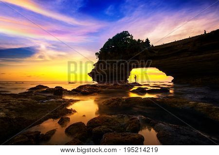 Seascape at Tanah Lot Temple and sunset in Bali Indonesia.(Dark)
