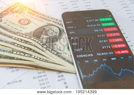 Business concept. Financial analysis Smaetphone and US dollars money. Vintage tone.