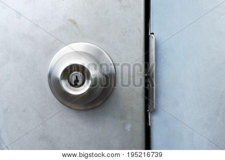 Close up image of an industrial door handle on a steel industrial door.