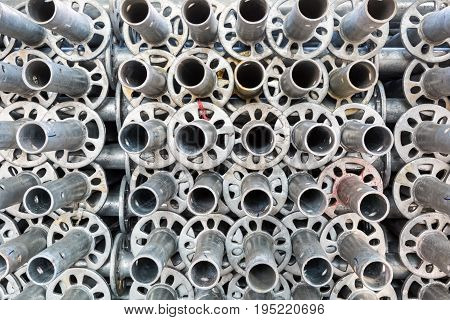 steel pipe of scaffolding closeup building materials background