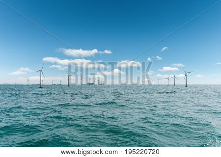 offshore wind farm with beautiful sea clean energy background