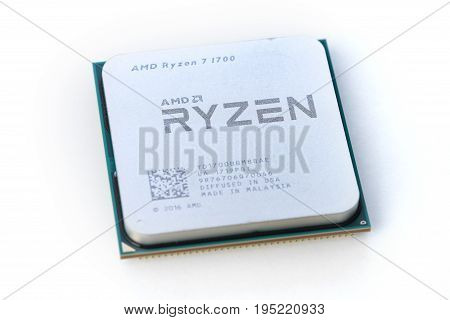 Melbourne, Australia - Jul 12, 2017: Close-up of AMD Ryzen 7 1700 CPU on white background. It is a high-performance microprocessor introduced by AMD in 2017.