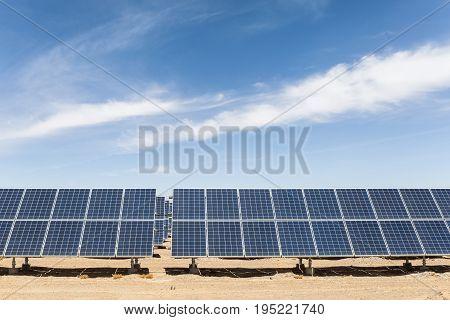 solar panels in golmud city new energy on the gobi desert against a blue sky