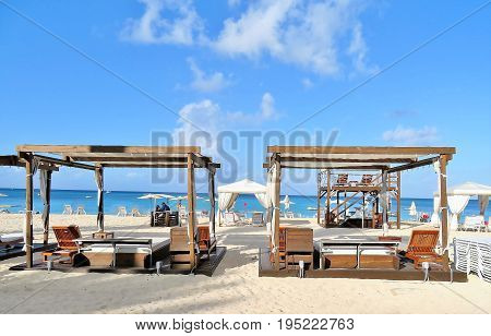 Beach cabanas and chairs on a white sandy beach
