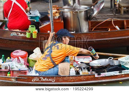 Ratchaburi Thailand - March 20 2016 : Pad thai on trader boats in a Damnoen Saduak floating market in Ratchaburi near Bangkok. Floating markets are one of the main cultural tourist destinations in Asia.