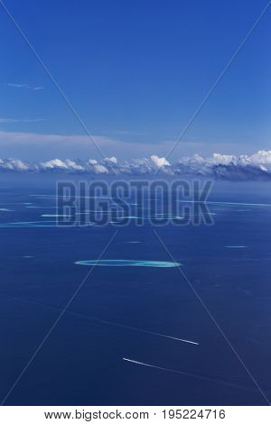 Group of atolls in Maldives view from seaplane window