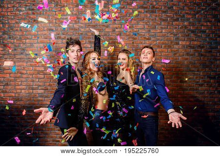 Friends having fun on a night party. Celebration, confetti. Christmas party.