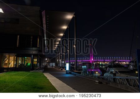 Melbourne, Australia - January 6, 2017: Library at the Docks and Bolte Bridge at Melbourne Docklands
