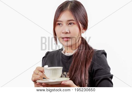 Portrait of young Asian woman drinking her morning coffee tea isolated on white background.