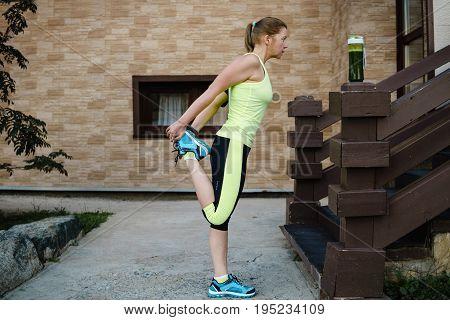 Running Stretching Runner Doing Warm-up Before The Marathon.