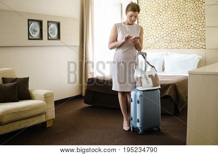 Businesswoman In The Hotel Using Cell Phone.
