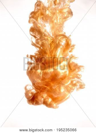 Ink swirl in a water on white background. The paint splash in the water. Soft dissemination a droplets of colored ink in water close-up. Abstract background. Explosion of color splashes acrylic ink.