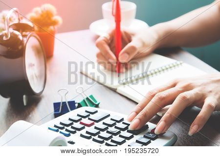Accounting concept Working woman using calculator, Business and Finance