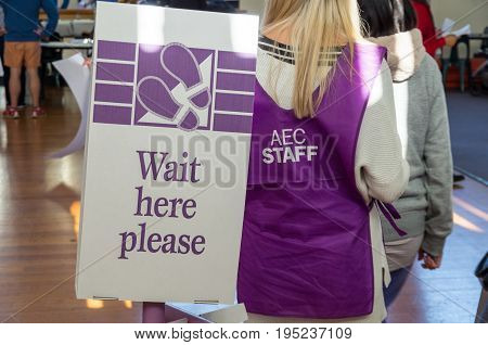 Melbourne, Australia - July 2, 2016: Australian Electoral Commission workers at a polling booth on 2016 federal election day.