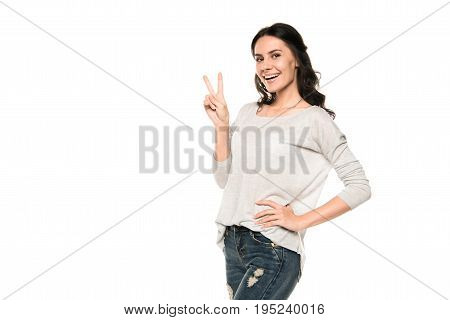 Attractive Happy Woman In Casual Clothes Showing Victory Sign, Isolated On White