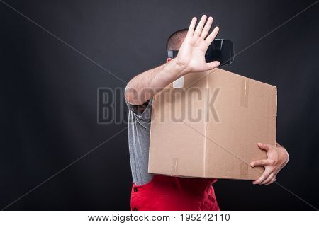Mover Guy Holding Box Touching Something Wearing Vr Glasses