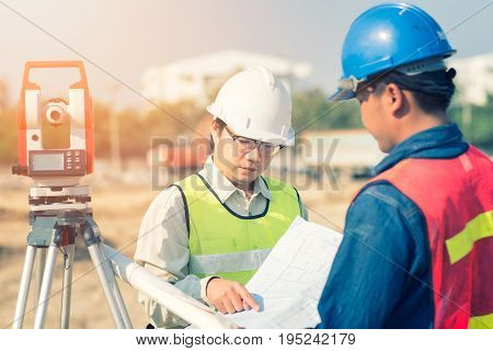 Construction Engineer With Foreman Worker Checking Construction Drawing For New Infrastructure Proje