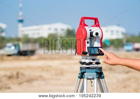 Civil engineer use surveyor equipment theodolite checking construction site for new Infrastructure project. photo concept for engineering work.