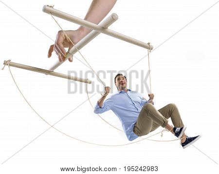 Partial View Of Hand Of Puppeteer Controlling Man On Strings Isolated On White