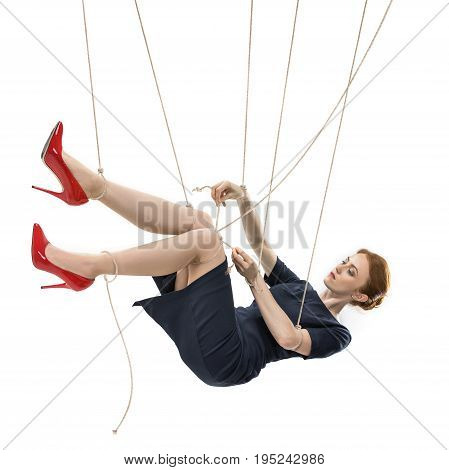 Businesswoman Trying To Break Free While Hanging On Manipulating Ropes Isolated On White