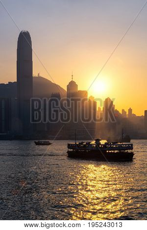 Hong Kong Traditional Wooden Chinese Boat For Tourist Service In Victoria Harbor At Sunset View From