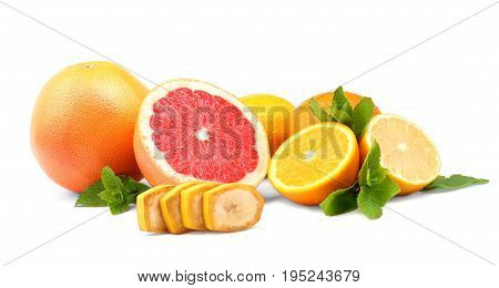 The tasty, ripe and juicy group of fresh citrus fruits, isolated on a white background. Citrus fruit halves and whole colorful composition with lime lemon, grapefruit, and oranges. Tropical vitamins.