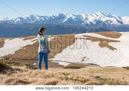 Woman Traveler  Stands On The Mountain Plateau