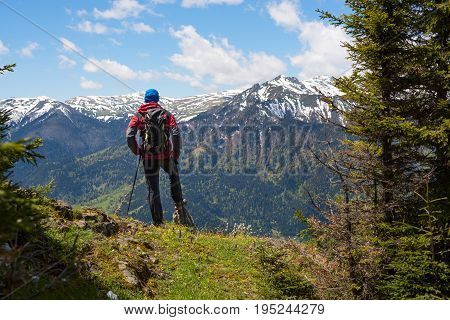 Hiker Admires A Panorama Of Mountains