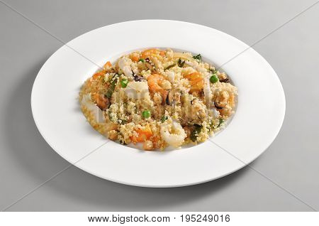 Dish with portion of cous cous and fish isolated on grey background