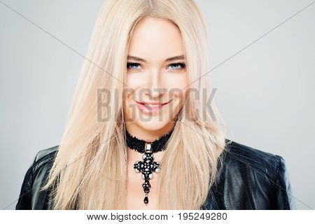 Beautiful Blonde Woman with Blonde Hair and Gothic Jewelry Necklaces. Blondie Fashion Model with Shiny Hairstyle and Natural Makeup