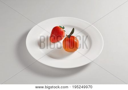 Round dish with two Marzipan sweets isolated on grey background