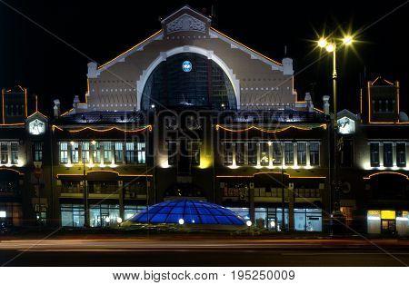 Illuminated Besarabsky Market at night. Ukraine Kiev.