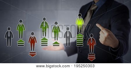 Blue chip HR manager is pointing at the best performing employee in a virtual assessment chart evaluating eight white collar workers. Business concept for electronic monitoring of performance.