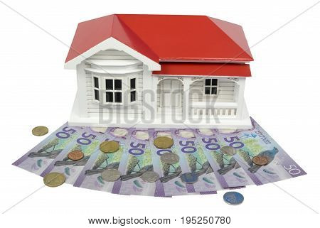 Bungalow villa house model with New Zealand NZ $50 Dollar notes and coins in cash