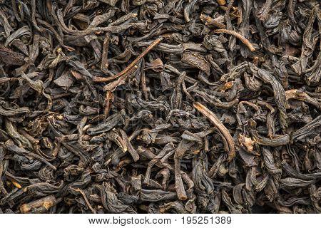 texture of Chinese souchong black tea, macro image of loose leaves