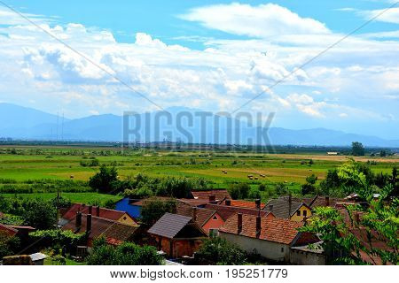 Aerial view of the village Feldioara, Transylvania, in the area of the city Brasov, a town situated in Transylvania, Romania, in the center of the country. 300.000 inhabitants.