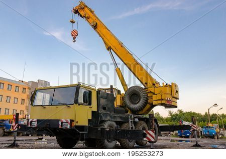 New road-construction equipment outdoors on the exhibition