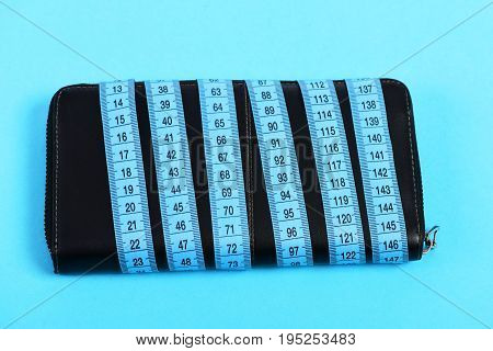 Purse In Black Color Wrapped Around With Cyan Measuring Tape