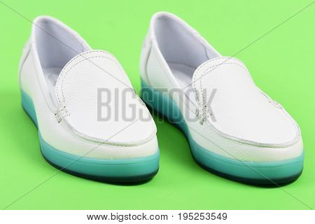 Pair Of Female Leather Shoes Isolated On Turquoise Green Background