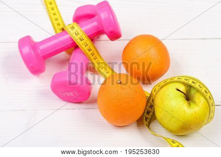 Training Concept, Dumbbells Weight With Measuring Tape, Fruit