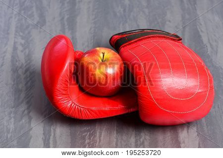 Boxing Gloves In Red Color. Pair Of Sportswear And Apple
