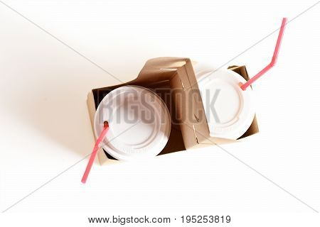 Paper Cups With Fizzy Drinks, Plastic Lids And Red Straws