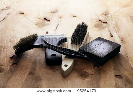 Assorted Sanding Tools on a Wooden Background