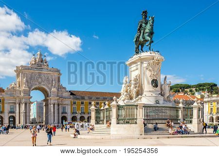 LISBON,PORTUGAL - MAY 18,2017 - Rua Augusta Arch and Statue king Jose I. at the Comercio sqaure in Lisbon. Lisbon is the capital of Portugal.